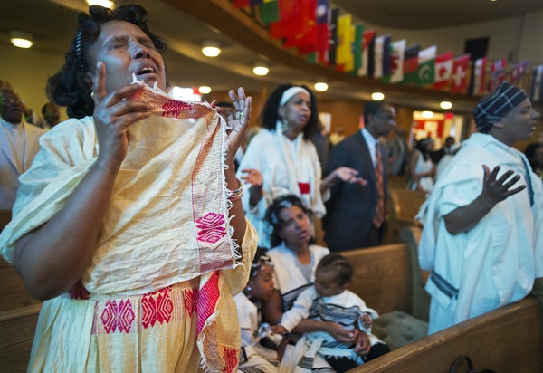Hiymanot Gudina, moved in prayer, has been attending the Oromo service at St. Paul's Evangelical Lutheran Church for the past four years, since she
