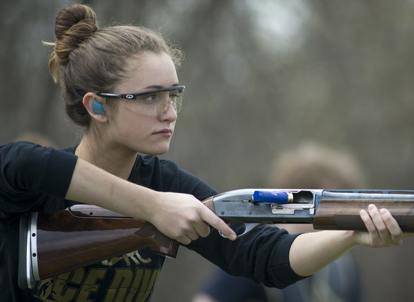 Wayzata High School junior Kerri Mueller looked down range after shooting a clay pigeon during a recent practice at Park Sportsmens Club in Orono.