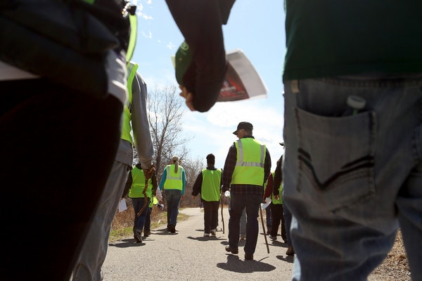 Christie and Robert Tarango of Bloomington walked to the search area hand and hand as they and other volunteers searched for Barway Collins.
