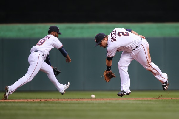 Brian Dozier, right, and Danny Santana miss a fielder during the Twins home opener against the Kansas City Royals at Target Field in Minneapolis on Mo