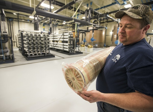 Foreman Chris Voeltz held equipment used in the reverse osmosis process at a water treatment plant in St. Peter, Minn.