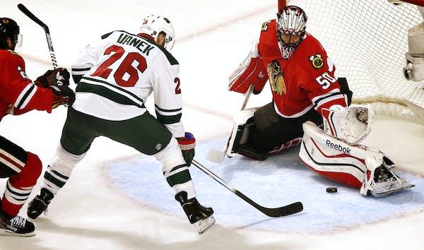 Blackhawks goalie Corey Crawford blocked a shot by Wild winger Thomas Vanek in Game 2.
