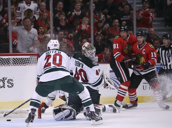 Wild defenseman Ryan Suter (20) couldn't reach the puck shot by Blackhawks center Jonathan Toews (19) in time to prevent the second period goal Sunday