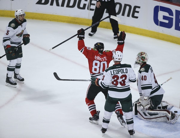 The Blackhawks' Antoine Vermette (80) celebrated what proved to be the game-winner by teammate Teuvo Teravainen (not pictured) in the second period.