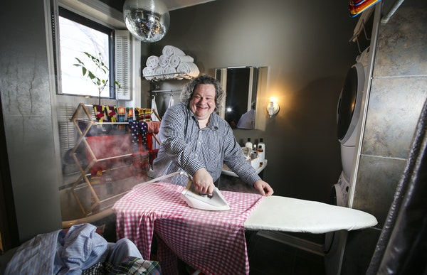 Patric Richardson loves doing his laundry in his laundry/bathroom at his St. Paul home. He uses a $250 iron that uses steam to iron his shirts.