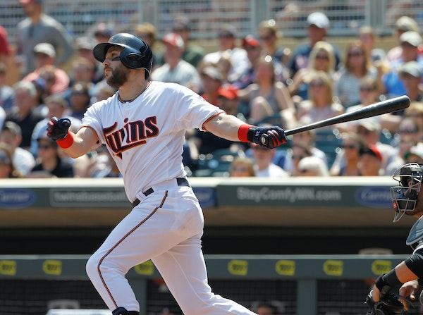 Minnesota Twins' Trevor Plouffe watches the flight of his grand slam off Chicago White Sox starting pitcher John Danks during the third inning a baseb