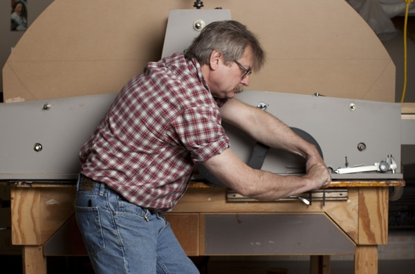 Kurt Nordwall uses a machine he built to reproduce archaic frame designs.