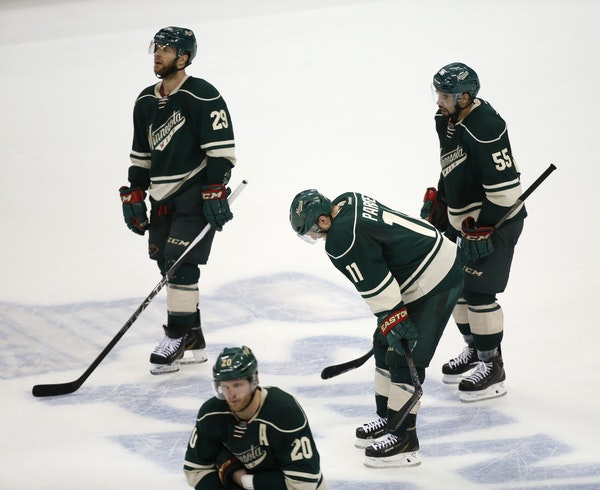 Heads hung as Wild players, from left, Jason Pominville, Ryan Suter, Zach Parise and Matt Dumba worked their way off the ice Thursday. The loss made i