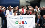 Members of the Minnesota Orchestra group pose for a group photo in front of their plane upon arrival at Jose Marti International Airport in Havana, Cu