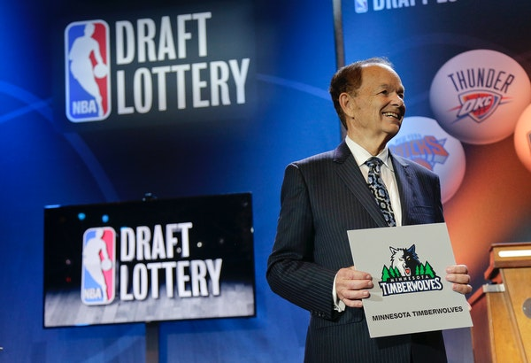 Minnesota Timberwolves owner Glen Taylor poses for photos after the Timberwolves won the No. 1 pick in the NBA basketball draft lottery Tuesday in New