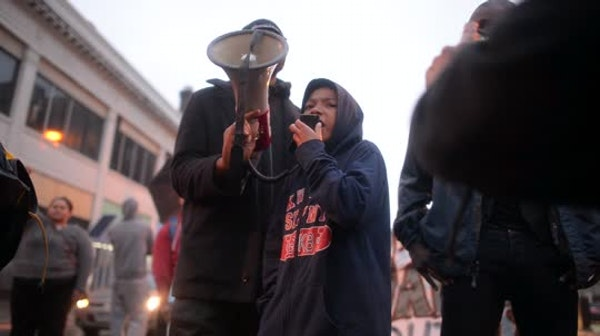 10-year old Taye leads chant at rally day after being maced