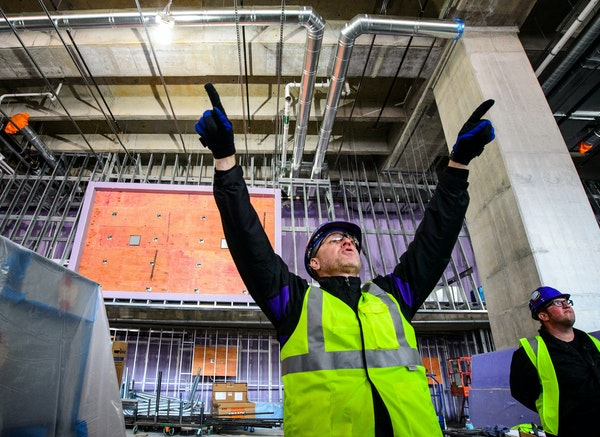 J.P. Paul, Vikings director for new stadium corporate development, pointed out where some of the 2,000 flat-screen monitors will be positioned.