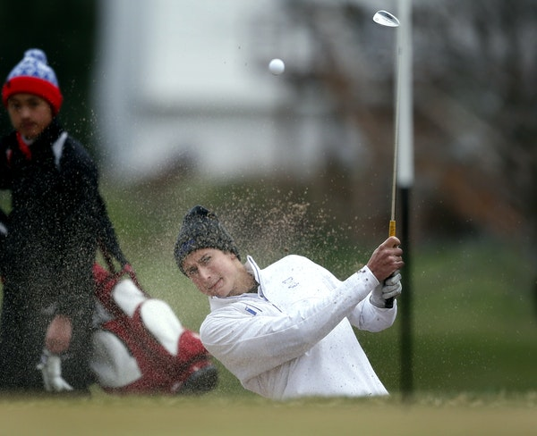 Grant Raja of Wayzata shoots out of a sand trap while playing in the Tri-State invitational at Edinburgh USA Golf course April 24, 2015 in Brooklyn Pa