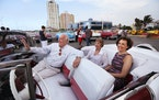 Stanley and Luella Goldberg, from left, and Ellen Luger of the People to People Tour group from Minnesota departs for dinner in a vintage Chevy BelAir