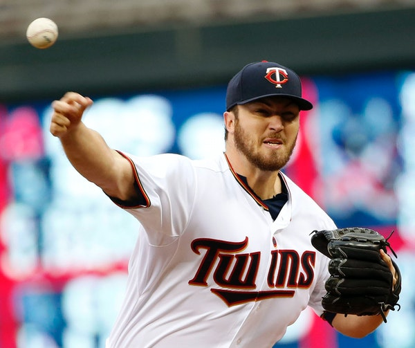 Minnesota Twins starter Phil Hughes fires a pitch during the first inning of their game with the Tampa Bay Rays at Target Field Friday, May 15, 2015,