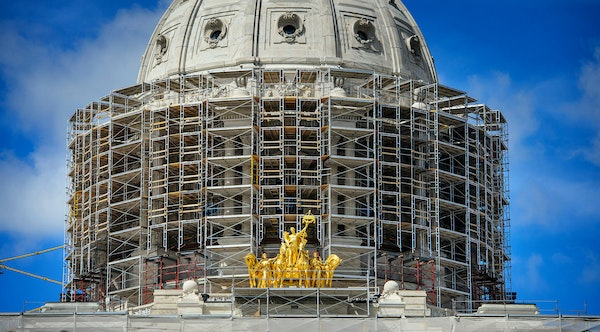 The State Capitol dome is surrounded by scaffolding put in place for renovations.