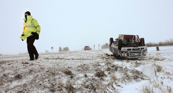 A rollover crash on Interstate 90 east of Austin, Minn., Dec. 20, 2012.
