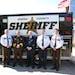 Anoka County Sheriff's Office Chief Deputy Tom Wells, Sheriff James Stuart, Bill Snoke, Jeff Czyson (both from Allina Health) and Cmdr. Brian Podany