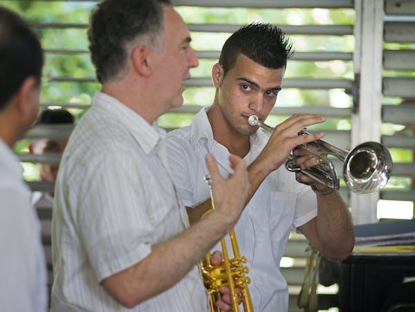 Minnesota Orchestra trumpeter Robert Dorer, center, gave student Antonio Diaz Martinez some tips during a visit to Cuba's Escuela Nacional de Músic