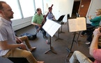 """Members of the Minnesota Orchestra (from left, Brian Mount, Chris Marshall, Greg Williams and Wendy Williams) rehearsed """"Libertango"""" at Orchestra"""