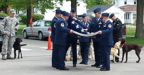 Grateful soldiers paid tributes at Stacy Dvorak's funeral, which also included many dogs who became, thanks to Dvorak, veterans' valued companions