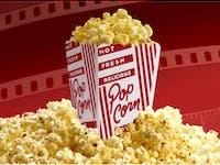 300 dpi 2 col. x 3.25 inches/108x83 mm/368x281 pixels Kurt Strazdins color illustration of a box of movie popcorn set in a mound of popcorn. KRT 2001