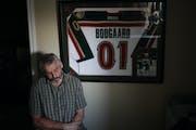 Len Boogaard, who encouraged his son Derek Boogaard's hockey career, next to Derek's jersey, in Ottawa, Ontario, Canada, Aug. 30, 2011.