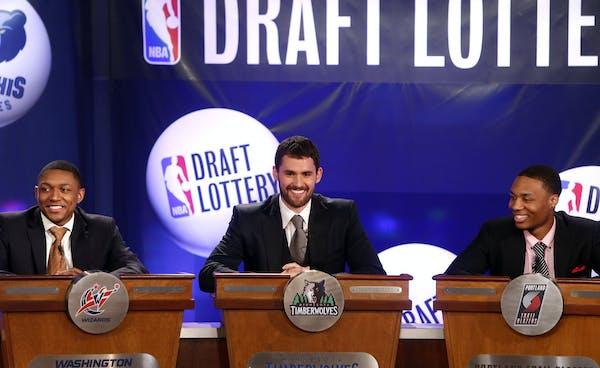 NBA basketball players, from left, Washington Wizards' Bradley Beal, Minnesota Timberwolves' Kevin Love and Portland Trailblazers' Damian Lillard repr