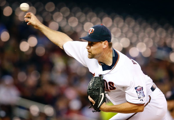 Minnesota Twins starting pitcher Mike Pelfrey (37) in the first inning.