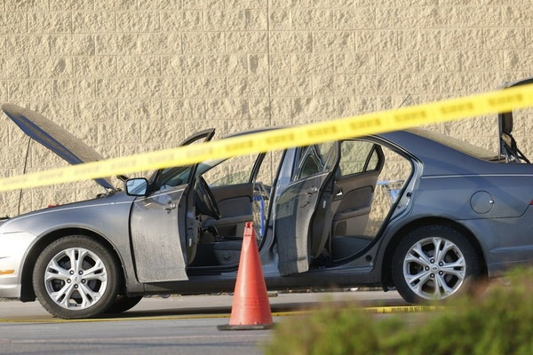 A car was investigated and searched near the entrance of Wal-Mart at the scene of a shooting on Tuesday, May 26, 2015, in Grand Forks, N.D.
