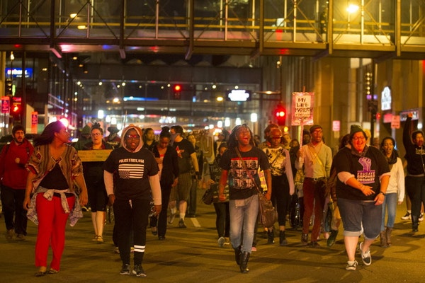 Between 50 and 100 protesters marched Wednesday night in downtown Minneapolis down S. 7th Street.