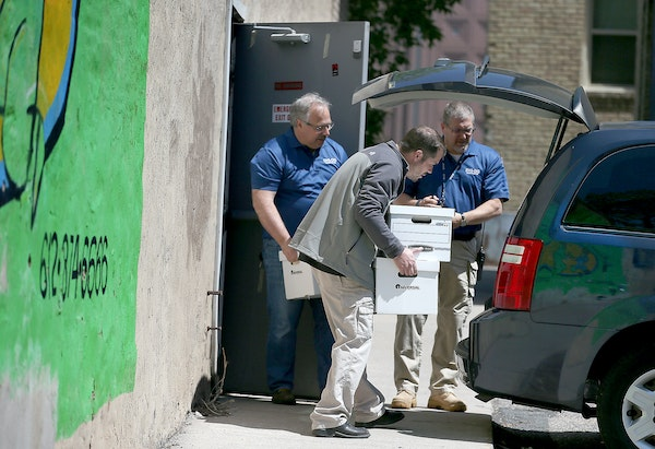 Officials from the DHS and BCA removed boxes and computer equipment from the Salama Child Care Center on Wednesday.