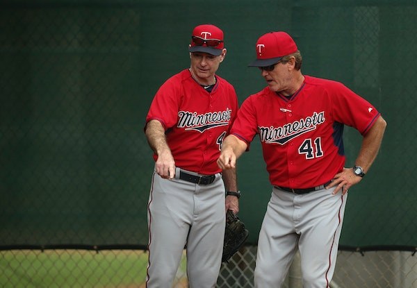 Twins pitching coach Neil Allen (41) and manager Paul Molitor (4)