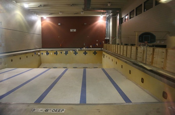 The pool at Phillips Community Center, seen in 2014, sat empty and closed through a through a viewing window.
