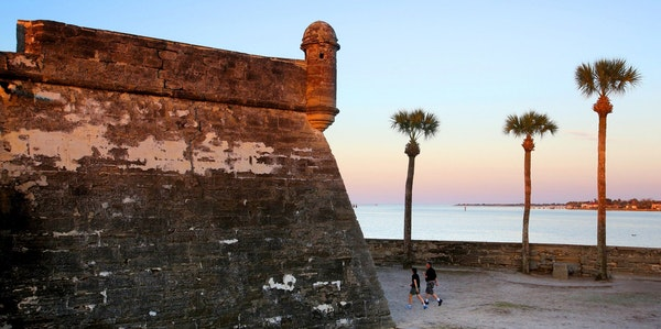 The Castillo de San Marcos of St. Augustine glows rosy in the sunset.