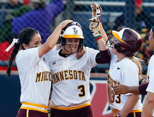 Minnesota's Erica Meyer (3) celebrates with teammates Erika Smyth (6) and Ellie Cowger (33) after defeating New Mexico State in a Division I NCAA coll