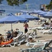 Tourists relax by the sea at Club Med in Grecolimano, Greece, on Friday, June 13, 2008. Club Mediterranee SA, Europe's largest resort operator, repo