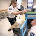Police inspectors Kathy Waite and Mike Sullivan assembled a Little Free Library at City Hall on Tuesday. The boxes will be placed inside precincts.