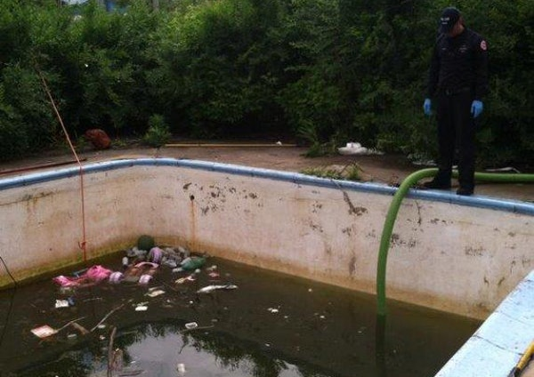 An abandoned pool at 1221 Arundel St. is now filled with about 6 feet of filthy water.