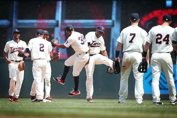 Minnesota Twins right fielder Torii Hunter (48), center, and other players celebrate their 6-4 win over the Boston Red Sox at Target Field in Minneapo
