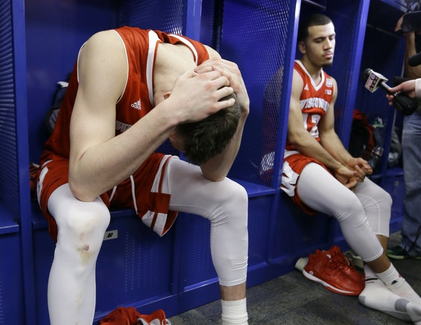 """Twitter users unloaded on Wisconsin forward Sam Dekker, left, after a cold shooting performance against Duke in the NCAA title game in April. """"Twitt"""