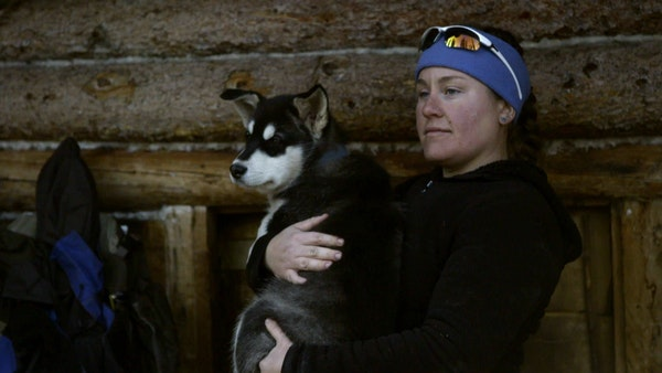 Ashley Selden, formerly of Lake Crystal, cradled one of her sled dogs, Gwen. She and her husband, Tyler, use a dog team in the Arctic National Wildlif