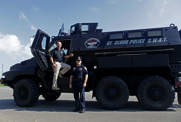 Sgt. Martin Sayre and Lt. Jeff Oxton of the St. Cloud police department SWAT team stood with their Mine Resistant Ambush Protected vehicle (MRAP), pre