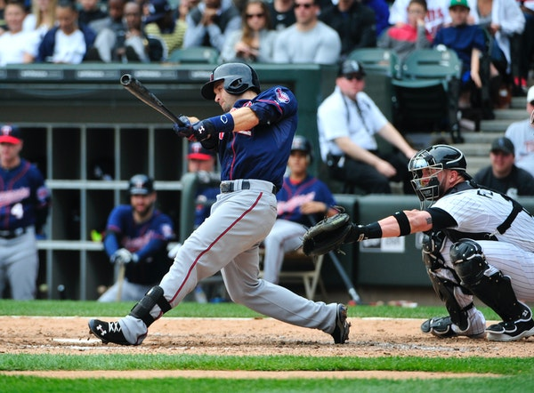 The Twins' Brian Dozier hit a three-run homer, his second of the game after a solo shot to lead off the game, against the Chicago White Sox during the