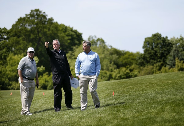 Left to right, NBC's Doug Grabert, PGA Chief Championships Officer Kerry Haigh and T&B Equipment Company's Berk Ellis surveyed the grounds at Haze
