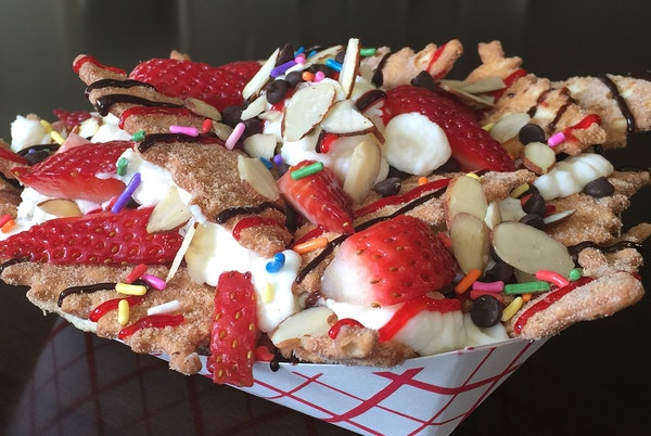 Italian Dessert Nachos: Cinnamon sugar cannoli chips smothered with sweet ricotta cheese filling, fruit, chocolate, nuts and candy toppings. Find it a