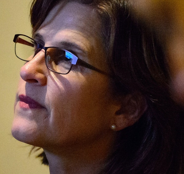 State Auditor Rebecca Otto watched the House proceedings in the hallway outside the chambers as her office was impacted by a surprise piece of legisla