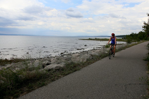 Margy Umhoefer of Sauk Centre, Minnesota, bikes along the shore of Little Traverse Bay on the Little Traverse Wheelway between Petoskey and Charlevoix