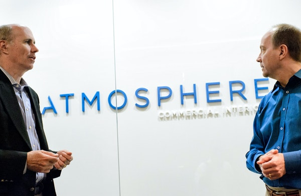Steelcase CEO Jim Keane, left, and Atmosphere CEO Mike Litwin. The former Target Commercial Interiors is a major Steelcase distributor.