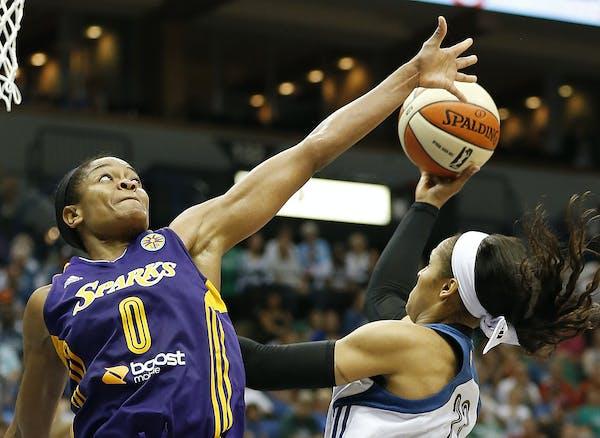 Los Angeles Sparks guard Alana Beard (0) tries to block the shot of Minnesota Lynx forward Maya Moore (23) in the second half of a WNBA basketball gam